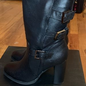 Faux Leather heel boots with buckles.